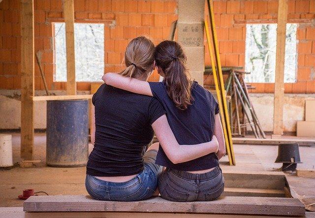 Two women sharing a hug image