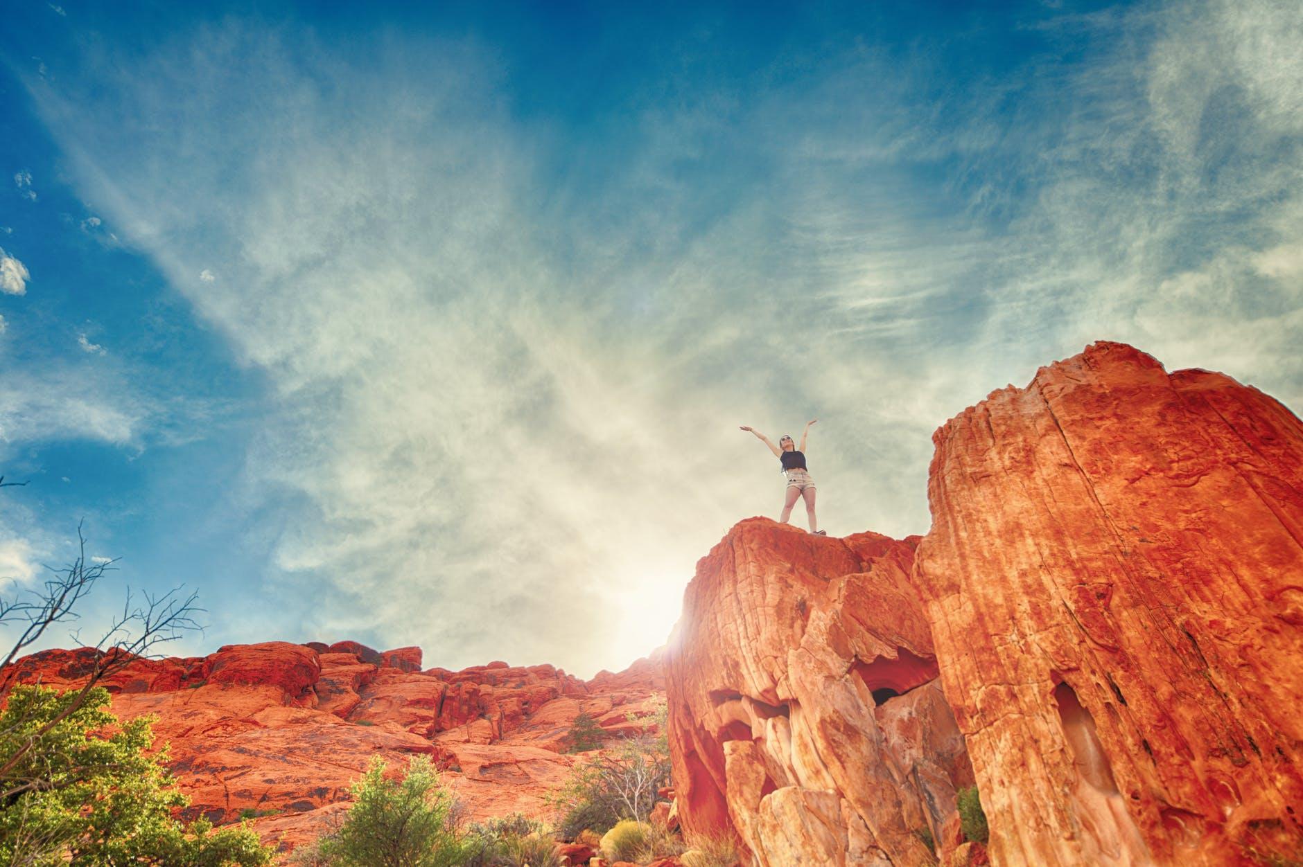 woman at mountain peak image