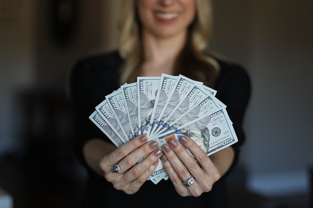woman holding money image