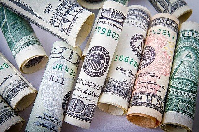 Money bills rolled up