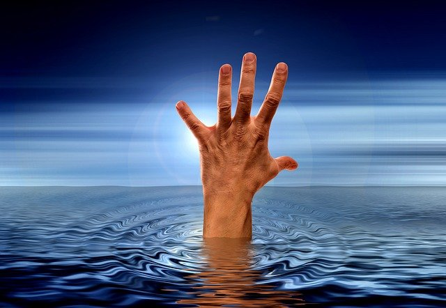 hand reaching out in water