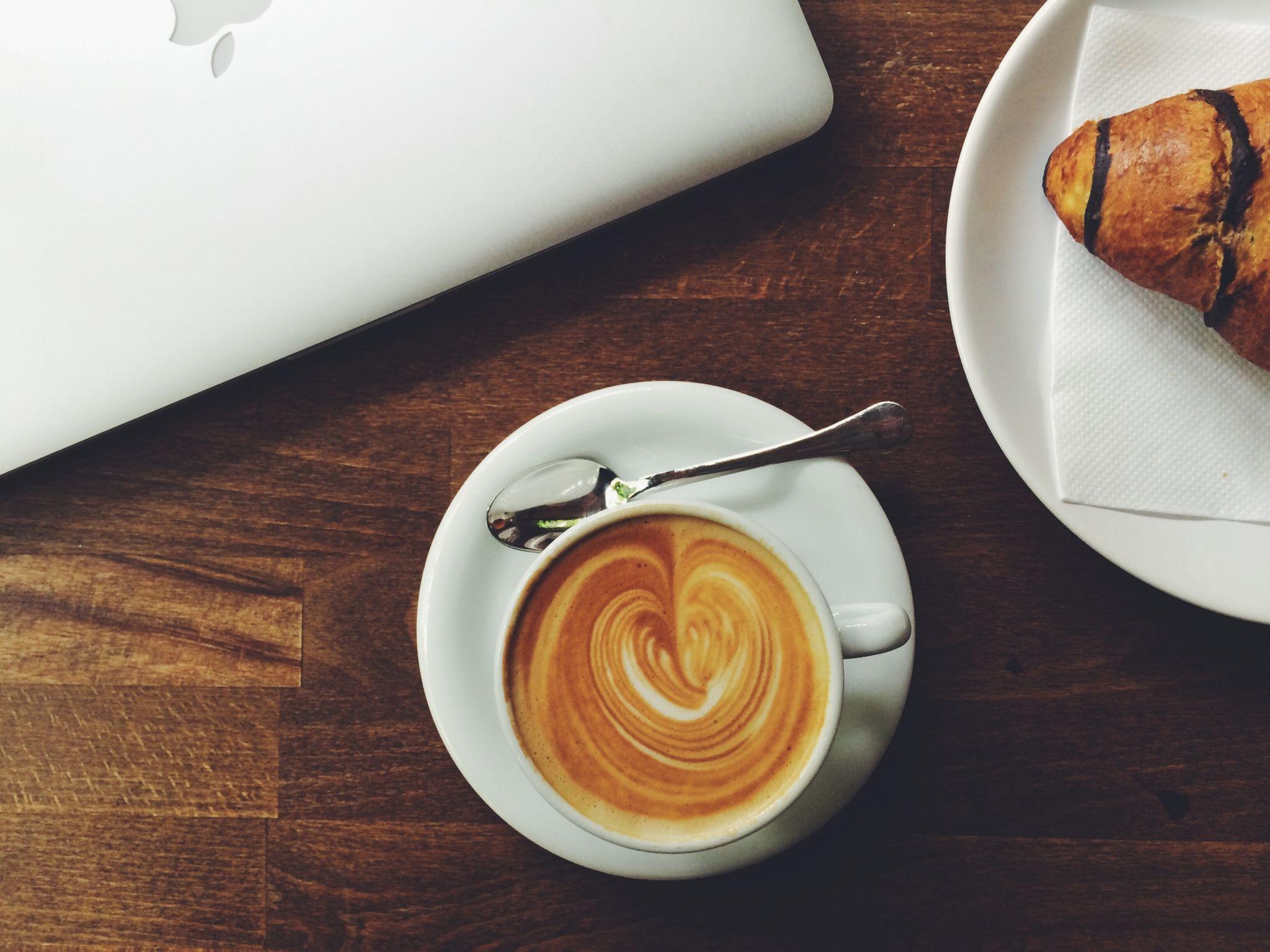 latte croissant laptop