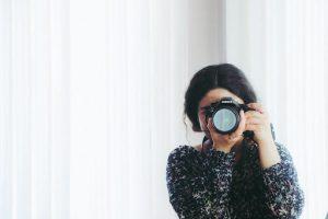 woman looking through lens